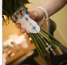 heirloom rosary used to wrap bridal bouquet