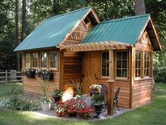 Love the metal roof and you could just stain the wood instead of having to paint all the time.