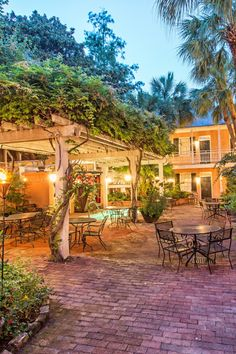 The palm-shaded courtyard makes a nice start for a culinary evening out. #Jetsetter