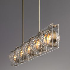 The Rochillon Chandelier is made by hand from brass and leaded crystal. The top plate, rods and body are machined from solid brass stock. The square crystal panels are cut on a diamond wheel and hand polished.  Finishes:Shown in Lite Antique Bronze (standard). Also available in Oil Rubbed Bronze, Polished Nickel, Satin Nickel and Dore.  Shade:Leaded Crystal.  Dimensions:54 L x 8 W x 51 H  Ceiling plate: 5.5 W x 32 L ceiling mount  Electrical:5 x E12 25w - ...