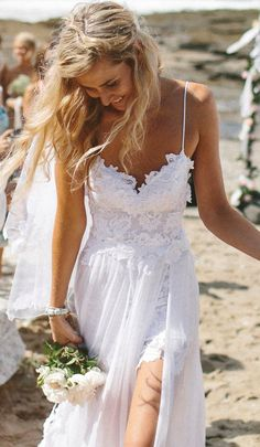 Great Beach wedding dress!  Stunning low back white lace wedding dress, dreamy floaty skirt and short lace front hem