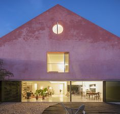 extrastudio transforms historic winery in portugal into secluded 'red house'
