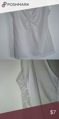 Little WHITE sleeveless top Charming. Very WHITE to show off your tan. Four buttons in front. Very open lace all down the sides. Cute. Spoiled Tops Tank Tops