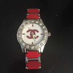 Watch Watch stainless steel red & silver. Worn a couple times great costume jewelry. Crystal rhinestones Accessories Watches