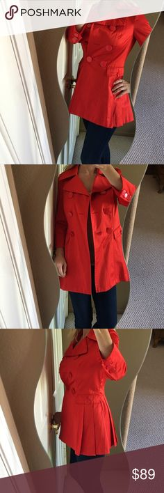 """✨Bebe Brand NWT Red Satin Pleated Back Trench✨ Make a statement in this stunning, holiday chic trench! Bright red satin, pleated back for a feminine touch, large shiny buttons, front double breasted closure, front faux pockets, large collar. Super comfortable on and in excellent condition! Brand new with tags still on, extra buttons included. Polyester/cotton blend fabric. About 17"""" from arm hole to arm hole and about 30.5"""" long. Fantastic jacket for any fashionista's closet❤️ bebe Jackets…"""