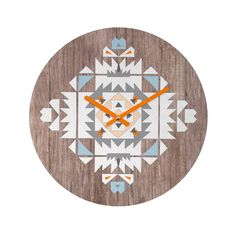 The look of weathered wood provides a chic background for the angular tribal-inspired design on this clock. It's topped with a splash of juicy orange from the playful hands.  Find the Tribal Bloom Clock, as seen in the #TheUrbanNomad Collection at http://dotandbo.com/collections/theurbannomad?utm_source=pinterest&utm_medium=organic&db_sku=91703