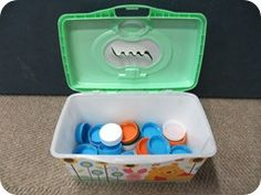 Keep a toddler busy. Drop milk lids through the slot of a diaper wipe container. Fill it up, dump it out, repeat.