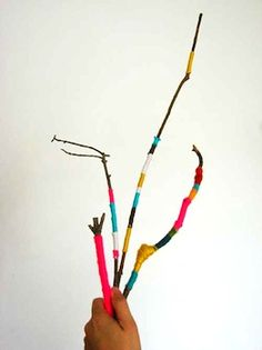 Wrap twigs up in coloured wool, place in a simple vase (or a painted wine bottle) for a cute, free decoration