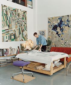 The painter Ian Hundley ironing in his Brooklyn studio.   Photographed by Lane Coder, Vogue, March 2006.