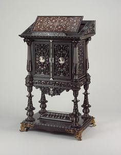 Bookstand Design attributed to Charles-Auguste Questel  (1807–1888) Maker: Workshop of Georges-Alphonse Jacob Desmalter (1799–1870) Decorator: Carved decoration by Chabraux Date: 1839 Culture: French, Paris Medium: Ebony, ebony veneer, ebonized maple, oak, maple, rosewood, snakewood, ivory, mother-of-pearl; brass hardware and mounts; lined with silk velvet not original to the piece