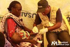 November 29: After seeing 300 cases of malaria in just one week, our staff in South Sudan examines a young patient for malaria at a transit facility for returnees. Photo: Margaret Aguirre, International Medical Corps, South Sudan 2012