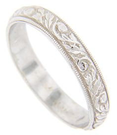 A scrolling floral pattern repeats around the circumference of this white gold antique style wedding band. Millgrain edges frame the center design. The ring measures in width. Size: 7 Cannot be re-sized, but can be special ordered in your size. Wedding Engagement, Wedding Bands, Groom Ring, Jewerly, Vintage Jewelry, Dream Wedding, White Gold, Ads, Antiques