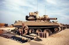 A soldier from Co. A, 3rd Bn., 73rd Airborne Armor Regt., 82nd Airborne Div., lays out equipment for an M-551 Sheridan light tank prior to the 82nd Airborne Division live-fire exercise during Operation Desert Shield.