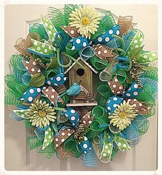 Bring A Breath of Fresh Air into your Home with this Lime and Robin Blue Birdhouse Deco Mesh Wreath.  It is made on a wired form with high quality Lime, Robin Blue, Cream and Burlap Deco Mesh.  There are pretty poke a dot ribbons in lime, baby blue and burlap with flex tubing in baby blue and lime.  Beautiful lime daisies with spring berries and leaves are showing all around the wreath.  The lime green birdhouse that is in the middle of the wreath is made from wood and shows with grape vines…