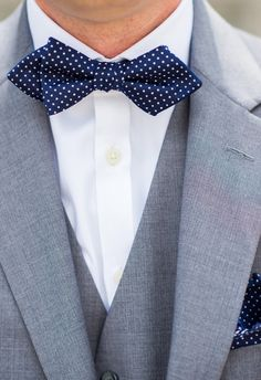 Polkadots, navy blue bowtie, gray suit // Vow & Forever