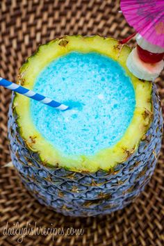 Umbrella Drink Blue Hawaiian Smoothie (1 cup of fresh pineapple juice  1/2 cup of banana rum 1/2 cup of Blue Curacao liqueur 1/4 cup of cream of coconut 3+ cups of ice)