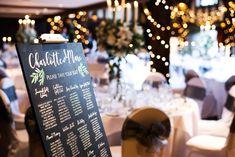 A fabulous white and gun metal themed Great Fosters Summer wedding.  #GreatFosters #GreatFosterswedding #GreatFosterphotographers #realwedding #weddingphotography #surrey #historicvenue #luxuryweddings #weddinginspiration #bridesmaids #greydresses #whiteflowers #theme #style #realwedding #tithebarn #barn #steelgrey #decor #candles #flowers #ideas #bestweddingphotographers #stylish #bridal #bridalparty #pronovias #tableplan #blackboard #weddingdecor #weddingideas #luxurywedding Great Fosters, Wedding Decorations, Table Decorations, Best Wedding Photographers, Table Plans, Surrey, Wedding Shoot, Luxury Wedding, White Flowers