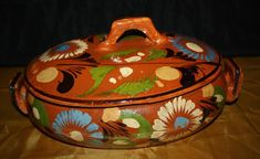 Another great find...  An old hand painted covered casserole from Mexico.