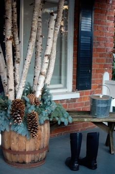 Boost your Rustic Winter Porch Decor with These 3 Objects - Though it's freezing outside, an average porch deserves a makeover. How about rustic design? You can start your rustic winter porch decor now. Christmas Planters, Christmas Porch, Outdoor Christmas, Rustic Christmas, Birch Christmas Tree, Christmas Fun, Birch Tree Decor, Branch Decor, Birch Logs