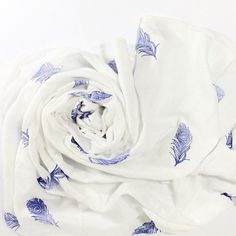 This extremely soft and light weight organic muslin blanket was made by me and then hand stamped in a mesmerizing blue peacock feather design and