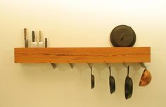Brooklyn–based Metropolitan Produce's Pot and Pan Rack, fashioned from a reclaimed beam inscribed with grooves for kitchen storage and bolted to the wall, is not for the faint of wallet: it's $3,500. However, it could serve as an inspiration for a DIY project.    http://remodelista.com/posts/slow-design-100-mile-brooklyn-kitchen#