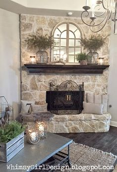 whimsy girl: Our Home: {Nature Inspired Spring Mantle} Spring mantle décor, neutral color living room, jute rug, metal coffee table, stone fireplace, ferns. arch mirror, mantle décor, jute rug.