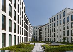 Zurich office block by Max Dudler features a gridded granite facade.