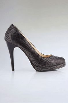 Court shoes crafted in PU, featuring a rounded almond toe, a low cut vamp with zebra effect to the main, platform to front with a stiletto heel.