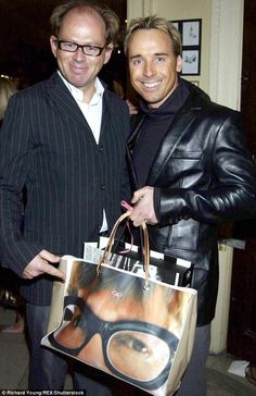 David Furnish was seen with his trendy tote, printed with what appears to be a picture of Elton John