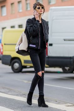 Ripped jeans, ankle boots, and a bomber jacket - this is how you wear black in the springtime. Click for more outfit ideas!