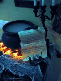 """Witch Cauldron // Place orange lights underneath for """"flame."""" Place green lights inside the cauldron (underneath the batting) for a """"witches brew."""""""