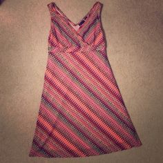Great Missoni-Inspired Dress Beautiful Missoni-inspired zig zag knit dress. Very flattering on, coloring works for all types. Criss-cross top detail with banding at empire waist line, slight A-line cut. EUC. Size Small. New York & Company Dresses