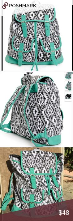 """Black and White w Mint Trim Backpack Black and white canvas with mint synthetic leather trim cinch top rucksack backpack. Taffeta lining with magnetic snap closures and padded adjustable shoulder straps. Top handle loop. 14"""" H x 15"""" W x 6"""" D. 60% cotton, 40% polyester. NWT. Inside zippered pocket is big enough for your phone and keys. Outside pockets 6"""" H x 6"""" W x 2"""" D. Bags Backpacks"""