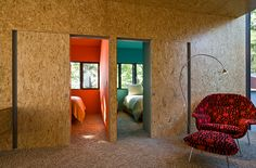 Love the idea of OSB as wall covering! Great use of a cheap material. The color in the bedrooms is nice too.