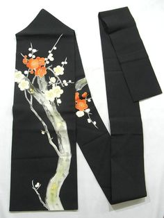 This is a Shioze Nagoya obi with red and white branched ume(Japanese apricot) flower design