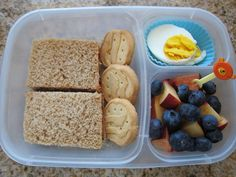 Almond butter and jam sandwiches, Trefoil cookies, two hardboiled egg halves, nectarines and blueberries in an an EasyLunchbox: