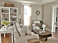 Living Room Gray walls white shelving starburst mirror
