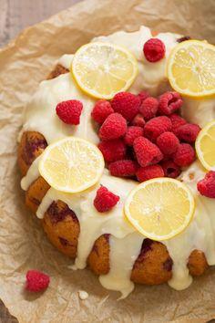 Glazed Lemon Raspberry Bundt Cake - A simple, tender bundt cake with pops of lemon zest and juicy raspberries!