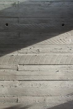 Natural textured concrete wall which has its own unique raw finish which is fantastic.