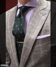 - Purple stripe cutaway collar dress shirt by Michael Andrews Bespoke - Grey windowpane suit by Michael Andrews Bespoke - Forest green silk tie by Robert Talbott - Sterling Silver tie bar by Tiffany & Co. - Lavender cotton pocket square by Michael Kors