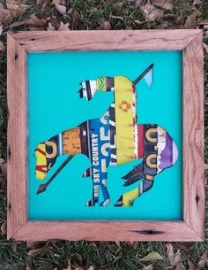 'End of the Trail', recreated with reclaimed barn wood frame, license plates, and a turquoise silhouette.    etsy.com/shop/QuillcoCreations