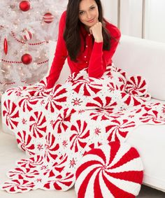Peppermint Throw and Pillow (pattern#  	LW4392) ~ experienced/ expert level crochet project designed by Bendy Carter ~ single-disc pillow and crocheted afghan from assembled rounds, in red & white candy motif perfect for Christmas | free pattern download & video tutorial by Red Heart Yarns