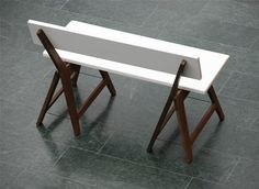 Designed by Jim Hannon-TanPaul Kogelnig & Gabriel Heusser  The idea is to extend the regular and well known trestles from the trestle table and making a bench. The seat and backrest you can take off easily and the trestles are folding up. Material: wood (wallnut) and white coated MDF