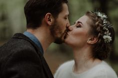 A bride and groom holding back the tears at an emotional first look, capturing by wedding photography duo The Kitcheners.