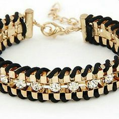 NOW AVAILABLE ! BLACK AND GOLD CRYSTAL BRACELET Gold metal, black leather, and crystals through the middle. Same pattern clasp to clasp Jewelry Bracelets