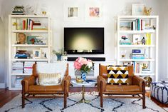 Not sure why chairs would ever not face the TV, but love the media layout. vintage-style-emily-henderson-souk-wool-rug-shag-parsons-bookshelves-storage-open-display-color