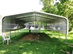 rabbit cages in carport.  This is an awesome idea!  Easily defensible and enclosable for predator and weather.