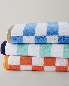 101 Beach House Must-Haves: Garnet Hill Offset Stripe Bath Towels in Aqua, Cornflower Blue, and Tiger Lily | $30 each