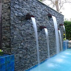 Customize your backyard pool with unique and eye catching water features from, waterfalls, gushers, scuppers, pencil jets and more! Swimming Pool House, Swimming Pool Water, Swimming Pool Designs, Platinum Pools, Waterfall Features, Pool Water Features, Water Spout, Water Walls, Custom Pools