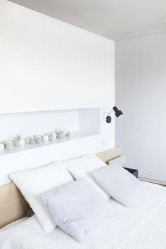 Timber Terrace - a bedroom with light furnishings and in white tone, featured on NONAGON.style
